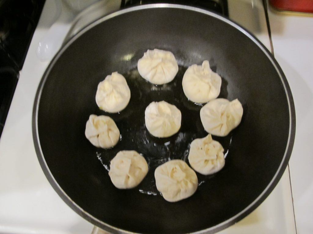 Raw Baozi in cooking pan
