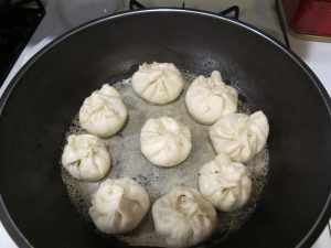 mixed water dry in fried baozi pan