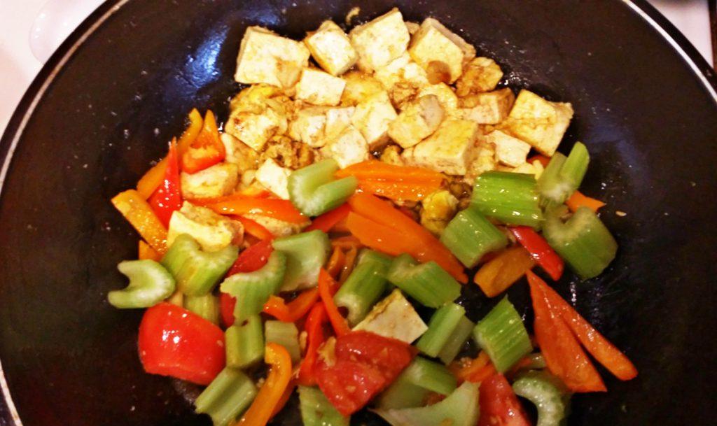 stir frying veggie with egg tofu